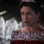 queen eva (played by rena sofer) wearing a red dress covered in way too many diamonds