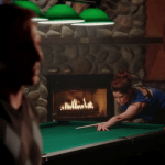 a screencap of lacey (played by emilie de ravin) playing billiards