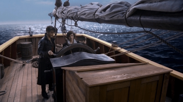 A SCREENCAP OF CAPTAIN HOOK (PLAYED BY COLIN O'DONOGHUE) TEACHING YOUNG BAELFIRE (PLAYED BY DYLAN SCHMID) HOW TO STEER A SHIP