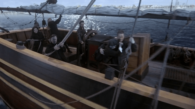 A SCREENCAP OF EMMA SWAN (PLAYED BY JENNIFER MORRISON), REGINA MILLS (PLAYED BY LANA PARRILLA), MR. GOLD (PLAYED BY REOBERT CARLYLE), CAPTAIN HOOK (PLAYED BY COLIN O'DONOGHUE), MARY MARGARET (PLAYED BY GINNIFER GOODWIN) AND DAVID NOLAN (PLAYED BY JOSH DALLAS) BRACING THEMSELVES ON A BOAT
