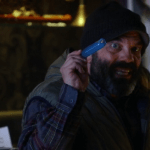 A SCREENCAP OF GRUMPY (PLAYED BY LEE ARENBERG) HOLDING A MAGIC MEMORY-RETURNING POTION
