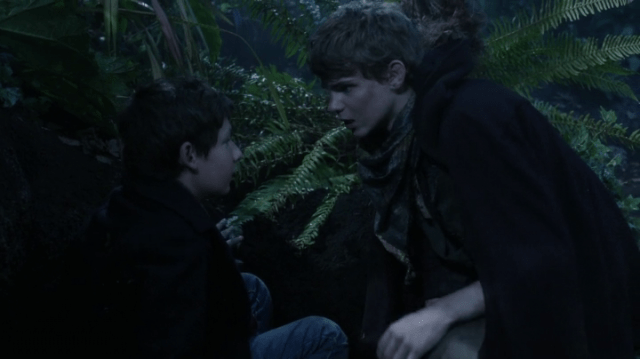 a screencap of henry mills (played by jared s. gilmore) meeting a blond boy (played by robbie kay)