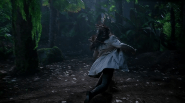 a screencap of tamara (played by sonequa martin-green) getting hit in the back by an arrow