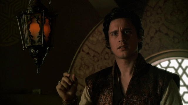 a screencap of cyrus the genie (played by peter gadiot)