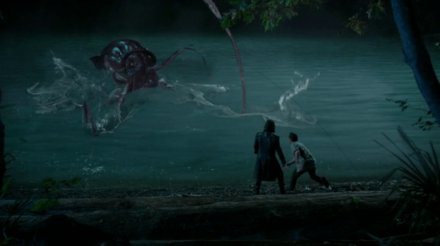 a screencap of rumpelstiltskin (played by robert carlyle) and baelfire (played by michael raymond-james) fighting a giant squid