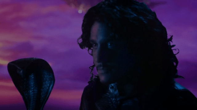 a screencap of jafar (played by naveen andrews) with some bad blue screening behind him