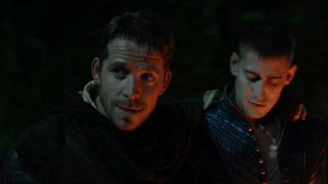 a screencap of robin hood (played by sean maguire) and will scarlet (played by michael socha)