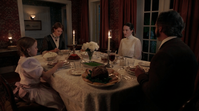 a screencap of alice (played by sopie lowe) at dinner with her family (played by john prowse, heather doerksen and kylie rogers)