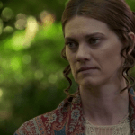a screencap of alice's stepmother sarah (played by heather doerksen)