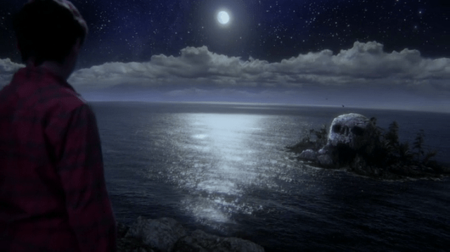 a screencap of henry (played by jared s. gilmore) looking out on skull rock