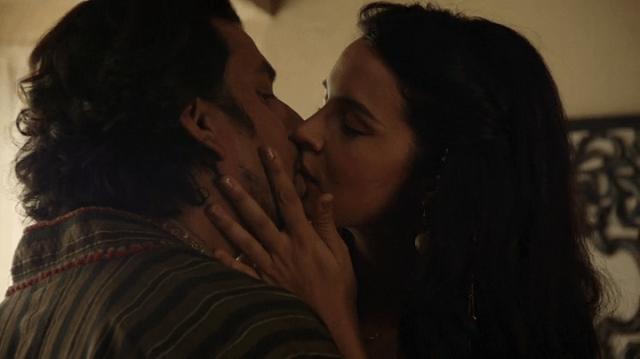 a screencap of jafar (played by naveen andrews) kissing amara (played by zuliekha robinson)