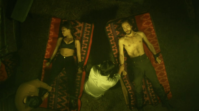a screencap of abbie mills (played by nicole beharie) and ichabod crane (played by tom mison) chained-up and shirtless