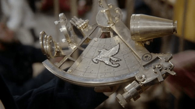 a screencap of a magical golden sextant with an image of a pegasus on it