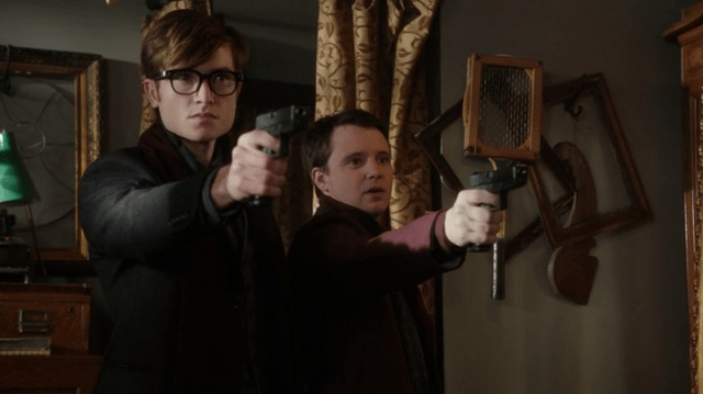 a screencap of john darling (played by matt kane) and michael darling (played by james immekus) pointing guns