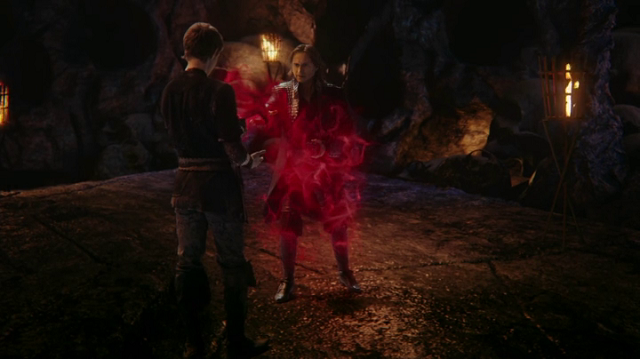 a screencap of peter pan (played by robbie kay) trapping rumpelstiltskin (played by robert carlyle) in pandora's box