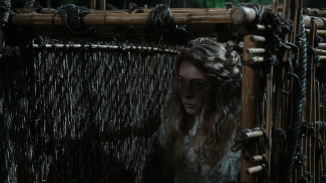 a screencap of wendy darling (played by freya tingley) in a cage