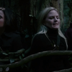 a screencap of regina (played by lana parrilla), emma (played by jennifer morrison) and snow white (played by ginnifer goodwin) trapped by vines
