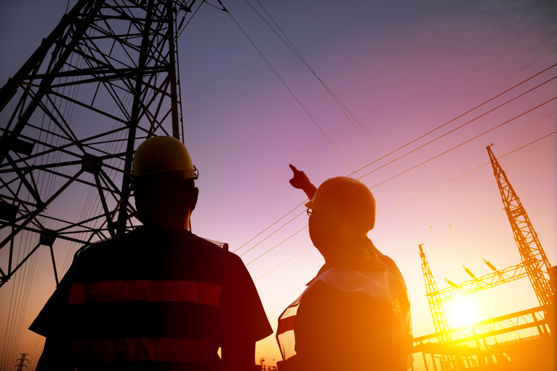 Engineers Working on Substation
