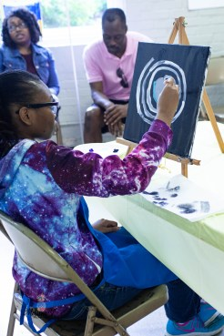 Strokes participant painting galaxy