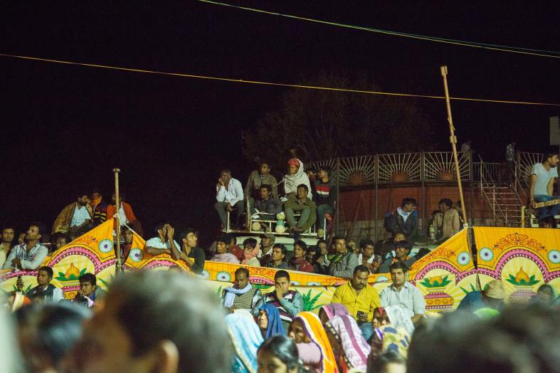 Eager villagers wanting a better view of the performance at Mohan Kheda