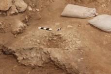Excavation of pebble hearth, Area E, 2013