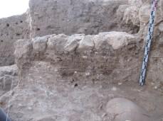 Earlier mudbrick walls beneath later EB III stone wall foundation, Area E, 2011