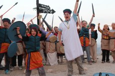 Boaz Greenfield and Aren Maeir, and crew having fun as Philistines atop the tell 2013