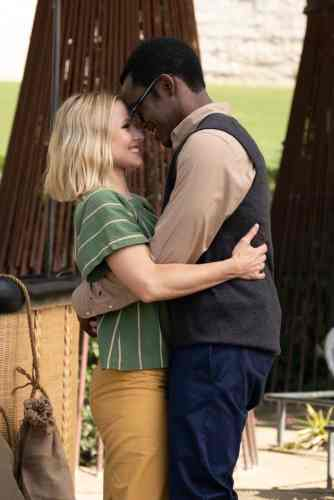 Black man and white woman embracing outside smiling Chidi and Eleanor The Good Place