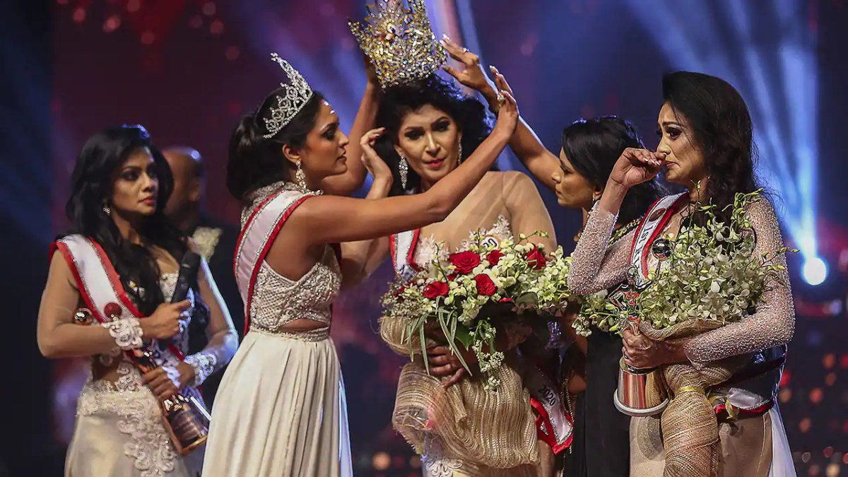 Mrs. World Caroline Jurie says she is 'prepared handy over the crown' after allegedly injuring Mrs. Sri Lanka
