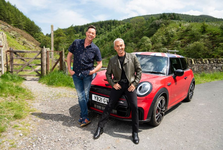 Pictured: Craig Revel Horwood and Bruno Tonioli with the Union Jack topped Red Mini that they use on there scenic drives. Picture: ITV