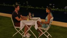 Brett and Priya have dinner.