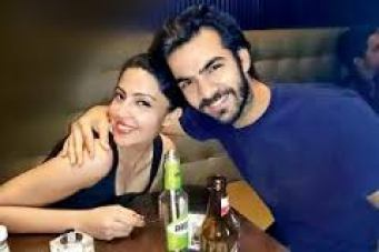 Karan V Grover with his girlfriend Poppy Jabbal