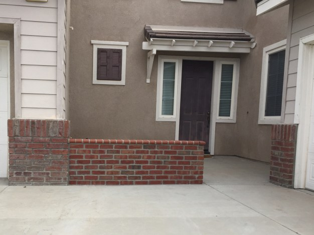 Brick faced wall in front courtyard in Temecula McCabe's Landscape Construction