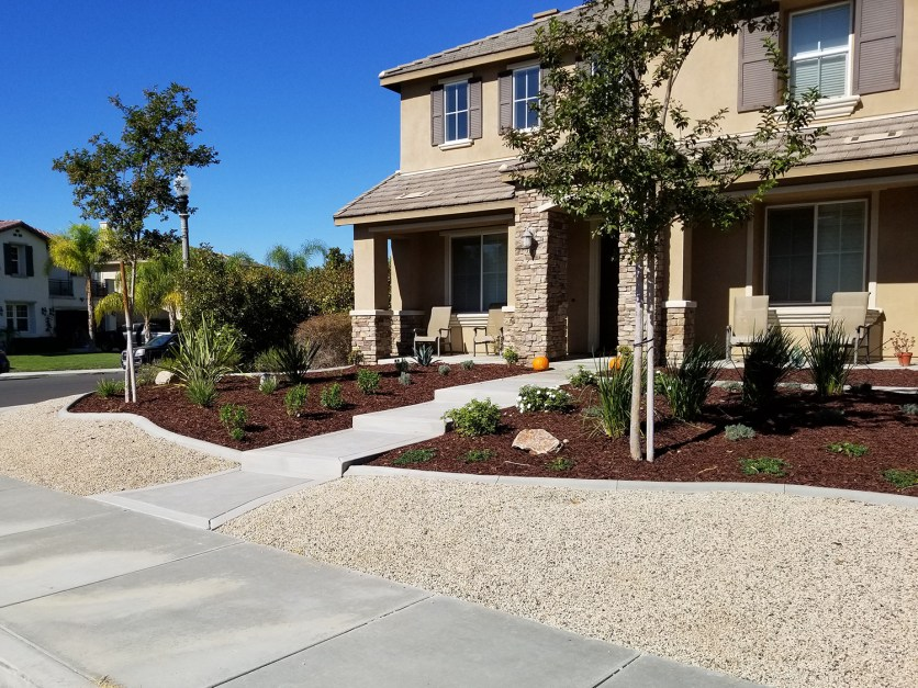 Grass free front yard with walkway