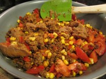 Add chopped tomato and refried beans (leftovers in this case).