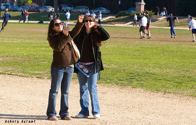 two women photographing washington monument