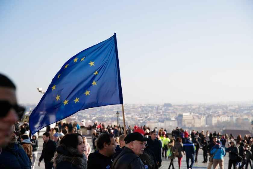 people on street with european union flag