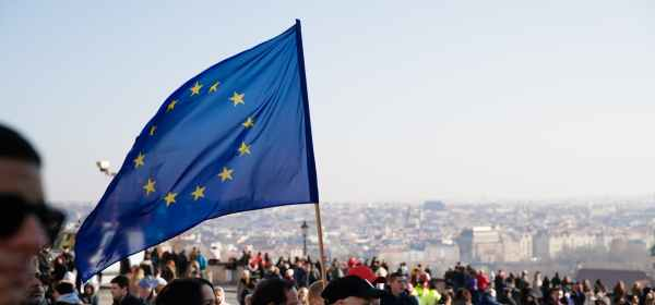 people on street with european union flag