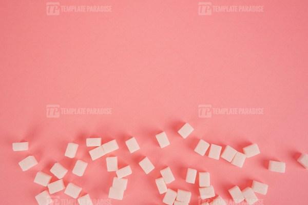 Cube sugar on bright pink stock image