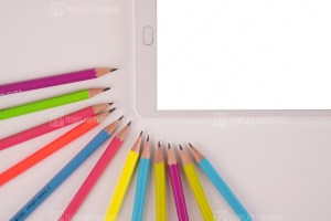 White tablet and color pencils