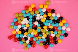 Colorful candy isolated on pink background stock photo