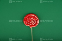 Colorful lollipop isolated on green background stock photo