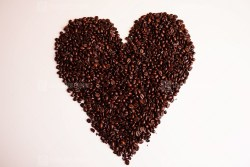 Heart shaped coffee beans stock photo
