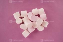 White marshmallow on purple background
