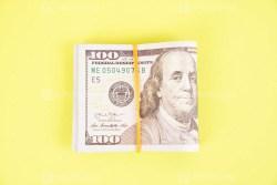 Bundle of money on bright green