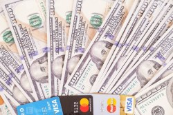 Dollar banknotes with credit cards