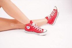 Hipster in red sneakers stock image