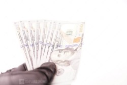 Man In Black Leather Gloves Holding Money