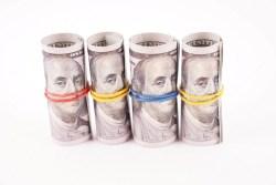 Rolls of 100 dollar bills stock photo