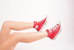 Sportive girl in red sneakers stock image